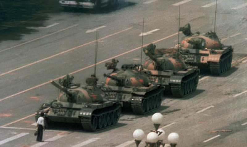 """The iconic """"Tank Man"""" photo of a man blocking a line of tanks on Chang'an Avenue near Tiananmen Square in Beijing on June 5th, 1989."""