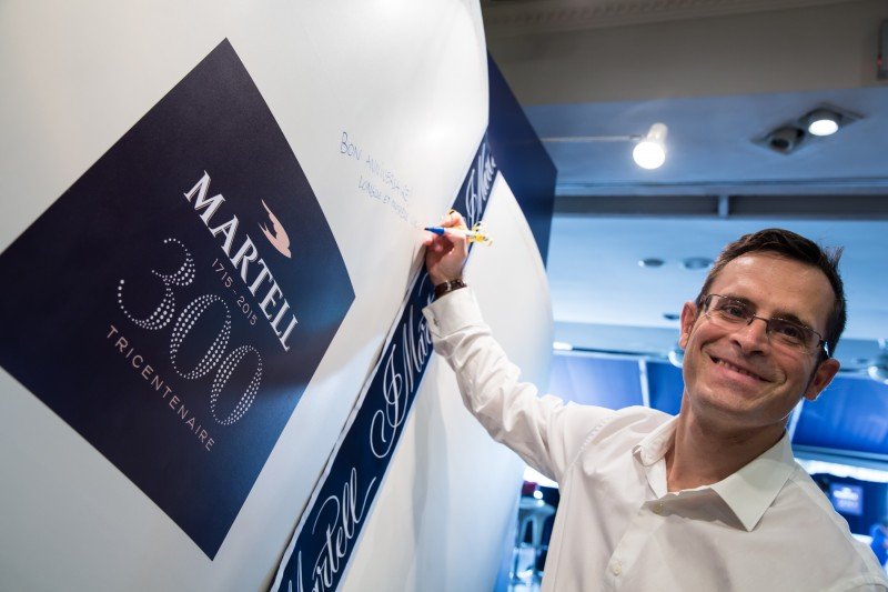 All smiles from Emmanuel Dokhelar, Marketing Director of Pernod Ricard Malaysia as he writes a birthday wish to Martell