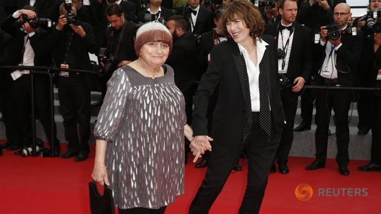 Film director Agnes Varda (L) and actress Jane Birkin pose on the red carpet as they arrive at the closing ceremony of the 68th Cannes Film Festival