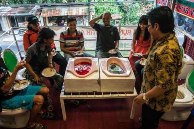 """Customers enjoy a meal at the """"Jamban Cafe"""" (Source: AFP)"""