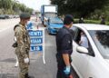 Brief Caption: Territorial Army personel and Police being helped by Rela member checking on motorists during manning the road block along Tun Dr Lim Chong Eu Expressway in an effort to curb Covid-19 influx in the 6th day of Movement Comtrol Order (MCO).Starpic by LIM BENG TATT/The Star/ 23 March 2020.