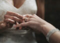 Cropped shot of two unrecognisable women exchanging rings on their wedding day